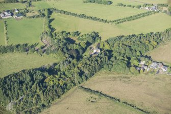 Oblique aerial view of Lickleyhead Castle, looking W.