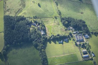 Oblique aerial view of Rothiemay House, Mains of Mayen, Mains of Rothiemay and Rothiemay Castle, looking SSE.