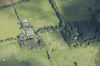 Oblique aerial view of Rothiemay House, Mains of Mayen, Mains of Rothiemay and Rothiemay Castle, looking NNW.
