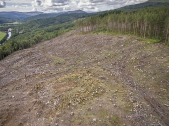 Pre-evaluation aerial photograph by Ed Martin, facing west over the dun looking over the hills in the distanc, Comar Wood Dun, Cannich, Strathglasse