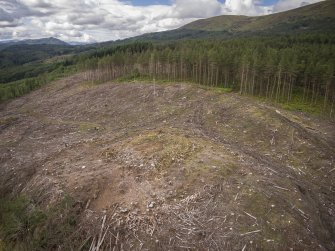 Pre-evaluation aerial photograph by Ed Martin, facing west over the dun looking over the hills in the distance, Comar Wood Dun, Cannich, Strathglass