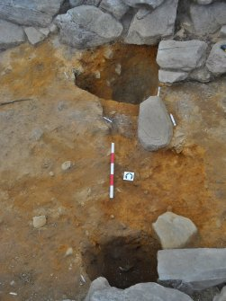 Post-excavation image of large postholes 122 and 124 and small stakehole 127, linked by 'sill' slot 129, 133, Comar Wood Dun, Cannich, Strathglass