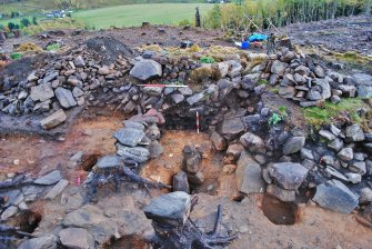 Looking over the entrance passage postholes to the north facing section of Trench 1, Comar Wood Dun, Cannich, Strathglass