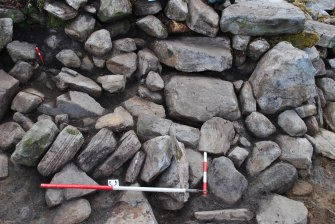 Stone 'stack' - possible collapsed walling, against Ssout side of entrance passage - outer wall face visible in top right corner of image, Comar Wood Dun, Cannich, Strathglass