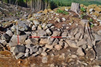 South facing trench section, showing rubble collapse and outer wall face (left), Comar Wood Dun, Cannich, Strathglass