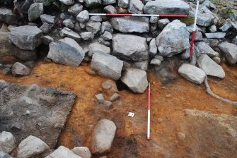 Remains of south face of entrance passage, showing natural subsoil and line of 'sill' crossing centre of image, Comar Wood Dun, Cannich, Strathglass
