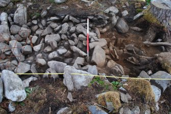 Working view - tree roots, loose small stones and rubble at the south end of Trench 2, Comar Wood Dun, Cannich, Strathglass