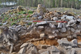 Post-excavation image of east-south-east facing trench section, south end, Comar Wood Dun, Cannich, Strathglass