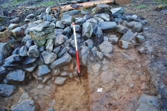 North west end of Trench 3 showing the east facing rubble wall of mostly collapsed courses of stone, Comar Wood Dun, Cannich, Strathglass