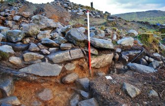 Outside face (south west facing) of the enclosure wall exposed in Trench 3, Comar Wood Dun, Cannich, Strathglass