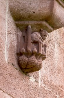 Detail of carved corbel under oriel window on West face.