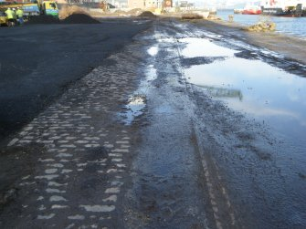 Cobble surface to the west side of the warehouse, photograph from watching brief at James Watt Dock, Glasgow