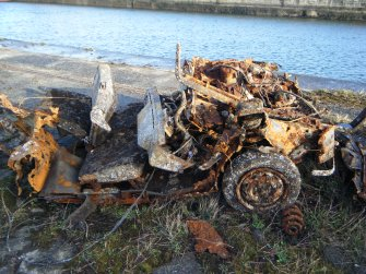 Burnt-out car, photograph from watching brief at James Watt Dock, Glasgow