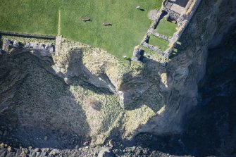 Oblique aerial view of the sea cliffs at Tantallon Castle, looking SW.