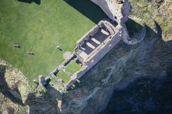 Oblique aerial view of the west wing at Tantallon Castle, looking SSW.