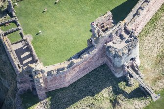 Oblique aerial view of the Mid Tower at Tantallon Castle, looking E.