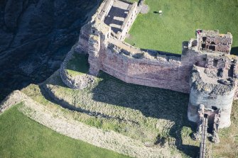 Oblique aerial view of the Douglas Tower and Mid Tower at Tantallon Castle, looking NE.
