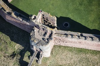 Oblique aerial view of the Mid Tower at Tantallon Castle, looking NE.