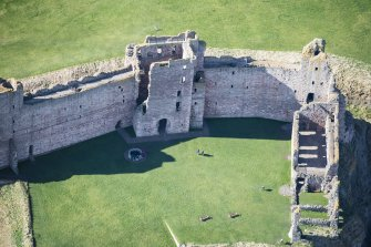 Oblique aerial view of Tantallon Castle centred on the Mid Tower, looking WSW.