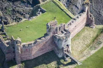 Oblique aerial view centred on the Mid Tower at Tantallon CastleOblique aerial view of the Douglas Tower at Tantallon Castle, looking ENE.