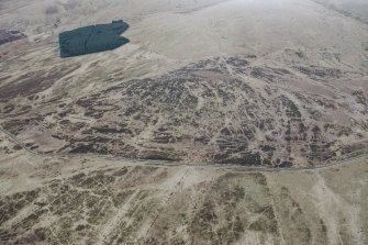 Oblique aerial view of military remains, tracks and rig and furrow at Sheriff Muir, looking E.