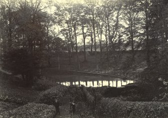 View of garden with two boys in foreground and curling pond in background, The Peel, Busby