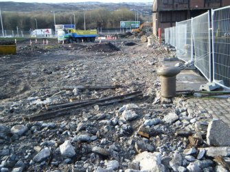 Area cleared of cobbles (facing N), during archaeological monitoring at James Warr Dock, Greenock