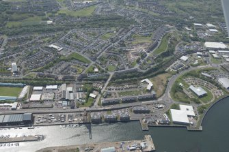 Oblique aerial view of the former site of James Watt Docks, Giant Cantilever Crane and Garvel Wet Dock, looking SW.