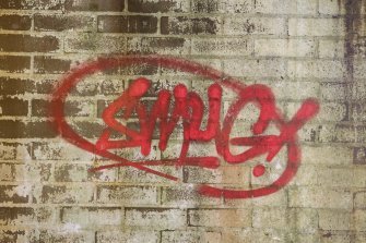 Laundry block. Detail of tag by Smug.