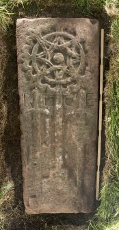 View of medieval recumbent grave slab Kirkmichael 1 (with scale).