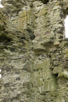 South east range, detail of stones with chamfer and stone with slot on inside of south west wall