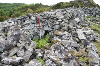 Cell at Point 4, and surrounding rubble, from N