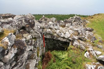 Partially intact corbelling at W end of cell, Point 5, from E