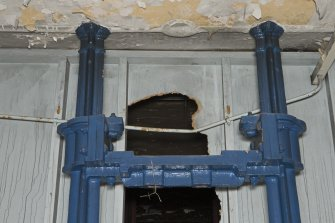 Interior. Old Mill (1808), ground floor. Detail of cast iron elements and line shafting bracket at north end.