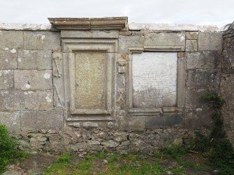 Rodel churchyard. Detail showing old and new panels in the burial enclosure of Donald Macleod of Berneray d.1781.