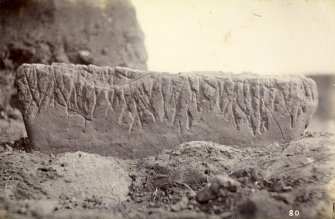 Photograph from Caithness Brochs album. Stone with ogham carving.