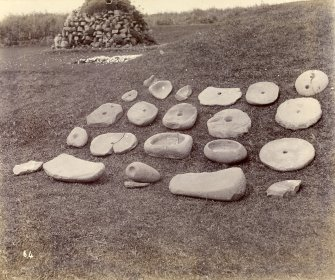 Photograph, Keiss Road Broch, showing collection of querns and stone vessels.