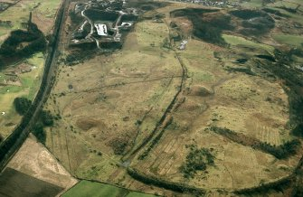NW oblique aerial view of Antonine Wall at Croy Hill Roman Fort.