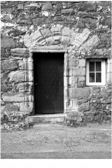 Detail of NE doorway with remains of arch above.