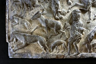 St Andrews Sarcophagus. Detail of hunting scene, lower left section of sarcophagus front panel. Panel 1.
