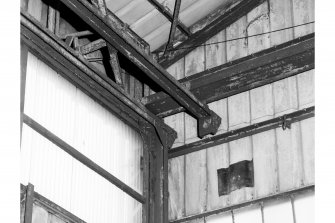 Interior-detail of end portion of overhead guide-rails for sliding doors of former flying-boat hangar