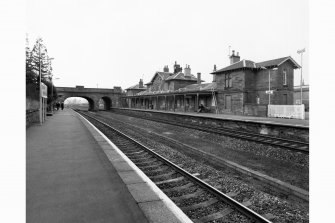 Station: view from E from Platform 1, showing main station buildings and bridge
