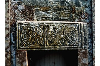 Detail of front of fragment of Anglo-Scandinavian cross-shaft incorporated as lintel over W door.