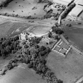 Oblique aerial view of Dairsie Castle and Dairsie Church centred on the castle and church, taken from the ESE.