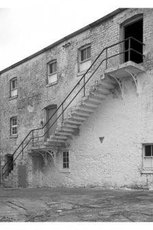 View of cantilever stair on south tower at Old Malt barn, Lagavulin Distillery, Islay.