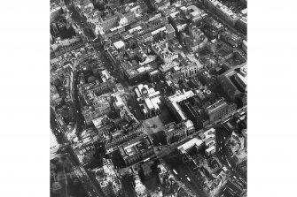 Oblique aerial view of centre of Edinburgh including Lawnmarket at bottom of photograph, Cockburn Street at left, South Bridge at top and National Library of Scotland, George IV Bridge at right
