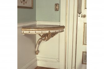 Interior. View of bracket table in corner of Dining Room.