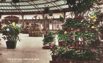 Coloured postcard view of interior of Wemyss Bay station.