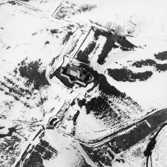 Oblique aerial view of Corgarff Castle in the snow, taken from the South.