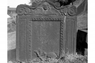 View of headstone for James Thomas, 1750: soul with volutes either side at top, panel with border.
